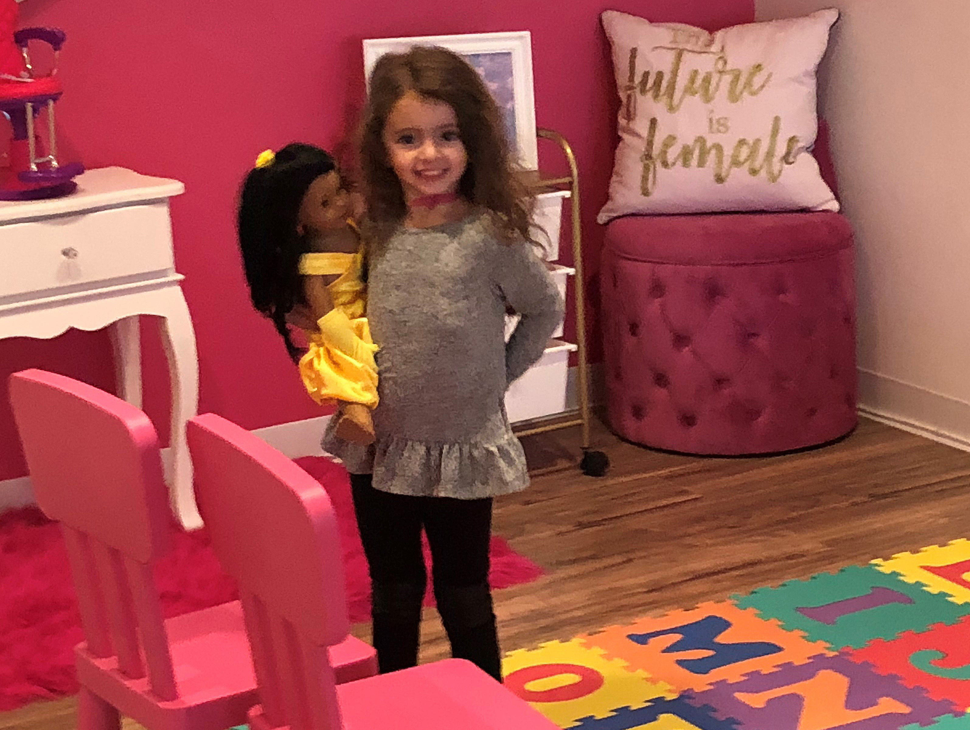 Stella Fiorentino, 4, hangs out in the play area of her mom's doll shop, Stella & Toni.