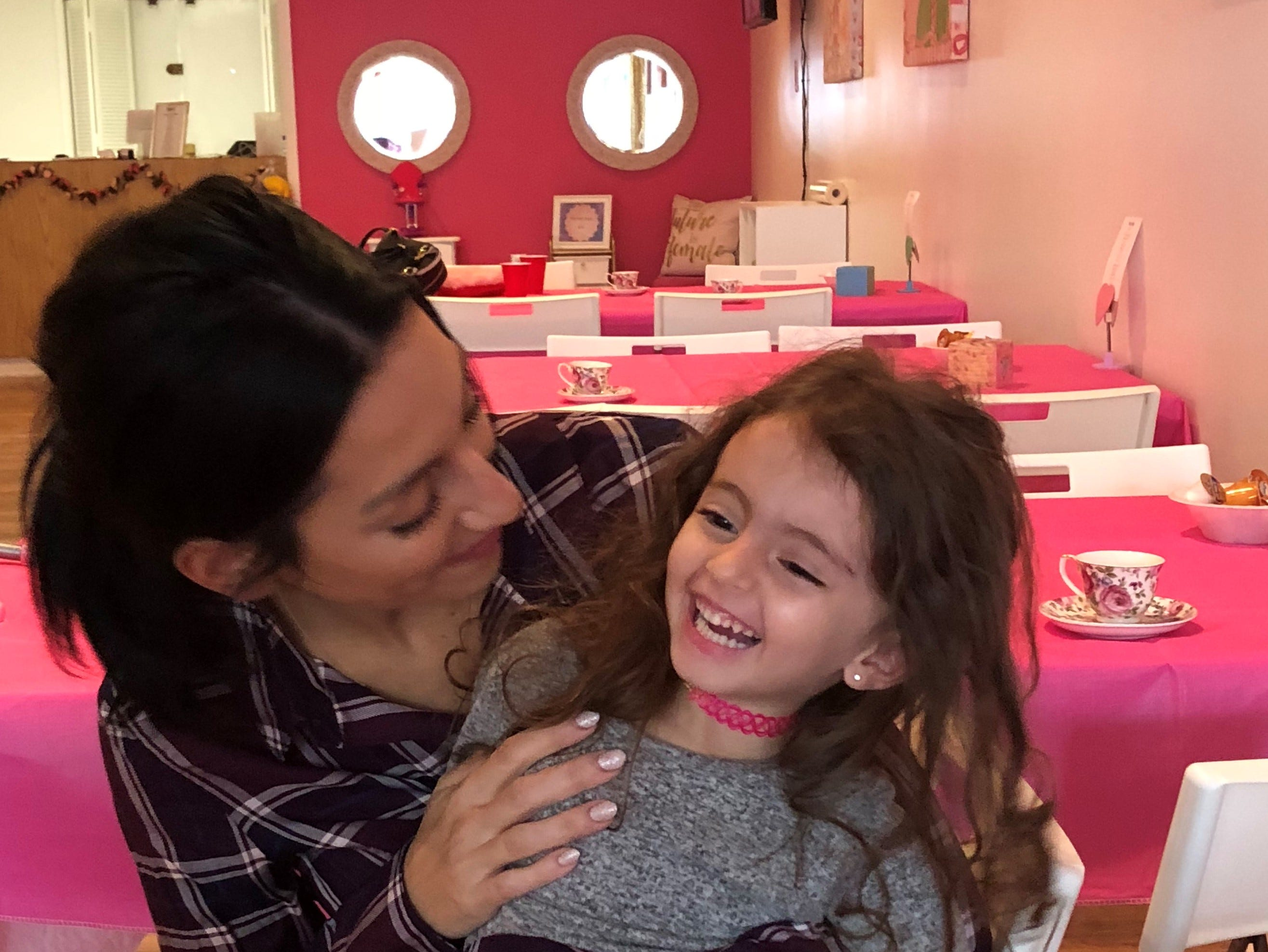 Melissa Fiorentino shares a laugh with her daughter Stella, 4, at Fiorentino's new doll store and party venue, Stella & Toni.