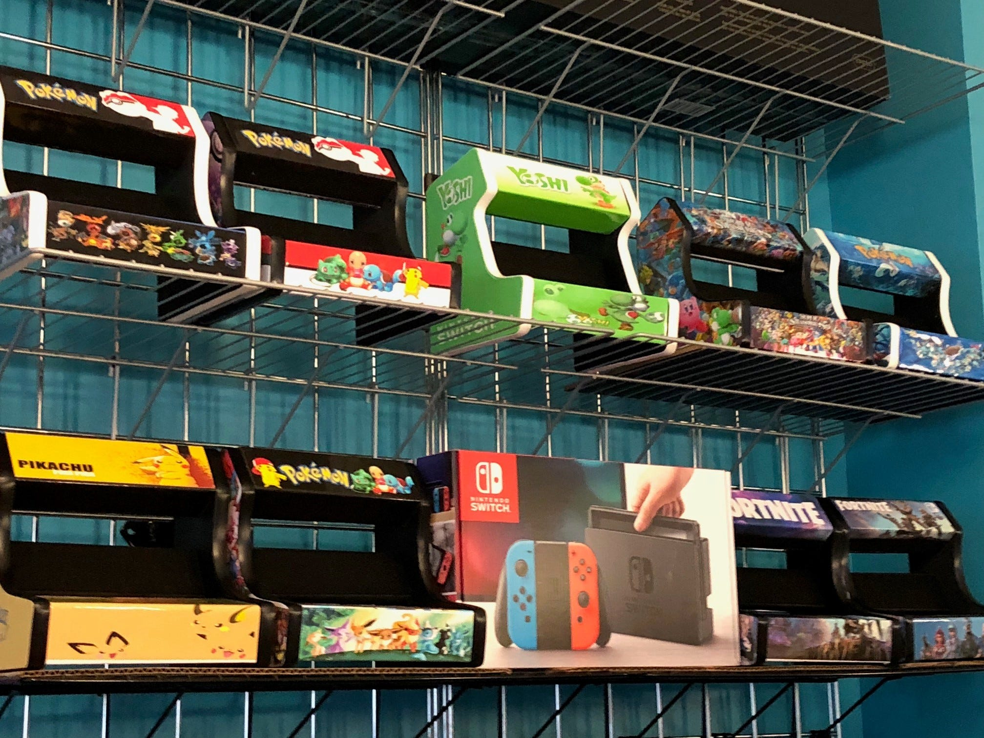 Custom-made holders for Nintendo Switch boxes are sold at Ninja's Little Toy House.