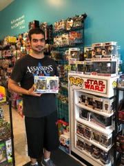 Manuel Senquiz of Ninja's Little Toy House in Haddonfield shows some of the Funko POP! figures that are a must-have for many collectors.