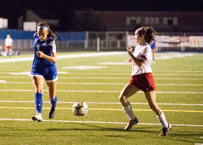 Chillicothe's Addie Erslan sidekicks the ball for her third score of the night before Zane Trace's Gracie Dunkle can steal. Chillicothe's girls soccer team defeated Zane Trace Wednesday night 5-1 at the Herrnstein Field at Obadiah Harris Family Athletic facility.