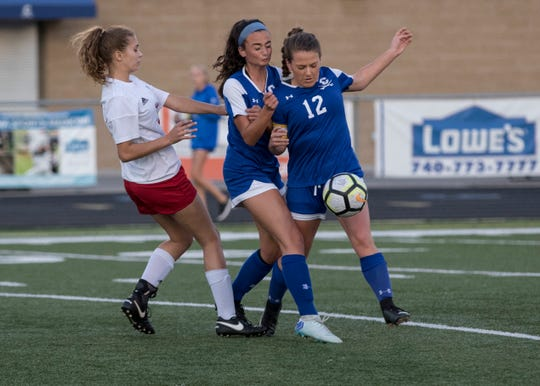 Chillicothe's Addie Erslan fights for possession of the ball in a 5-1 win over Zane Trace in 2018. Erslan went on to win the FAC Player of the Year award in 2018.