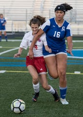 Zane Trace's Savannah Addy and Chillicothe's Olivia Johnson battle for possession of the ball. Chillicothe's girls soccer team defeated Zane Trace Wednesday night 5-1.