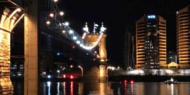 Crews rescued a person seen hanging under the John A. Roebling Suspension Bridge between downtown Cincinnati and northern Kentucky overnight.