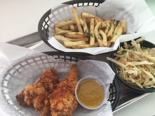 Chicken fingers, fries and ginger slaw from Money Chicken.