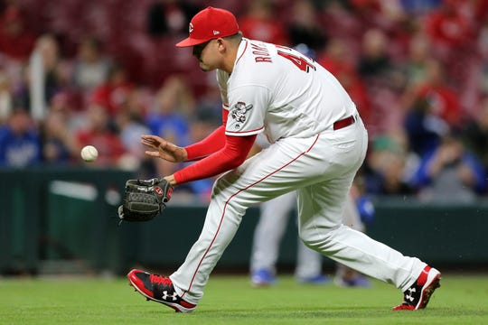 Cincinnati Reds starting pitcher Sal Romano (47) fields a groundball in the fifth inning during a baseball game between the Kansas City Royals and the Cincinnati Reds, Wednesday, Sept. 26, 2018, at Great American Ball Park in Cincinnati.