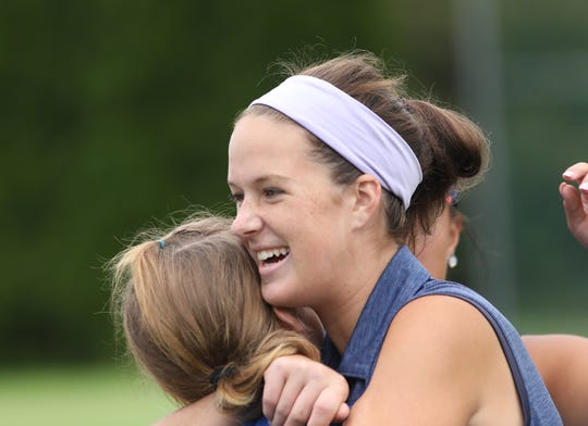 St. Henry's Lauren Mays celebrates after she qualified for the state tournament after a playoff hole during the regional girls golf tournament, Thursday, Sept. 27,2018.