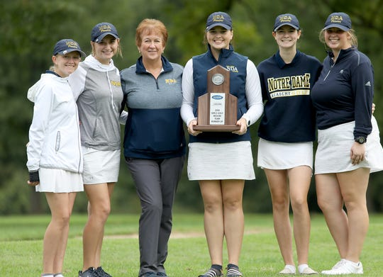 Notre Dame Academy golf team  Hannah Rice, Annie Gronotte, Karen Henderson (coach) Lauren Abner, Clare Hooper, and Lauren Meese with the team trophy at the regional tournament  Thursday, Sept. 27,2018.