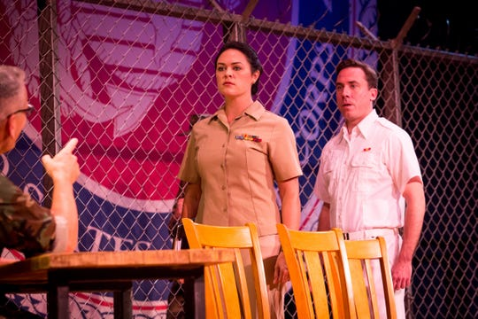 "Erin Carr, left, and Rory Sheridan are seen in a scene from Aaron Sorkin's ""A Few Good Men."" The show runs through Oct. 7 at the Covedale Center for the Performing Arts."