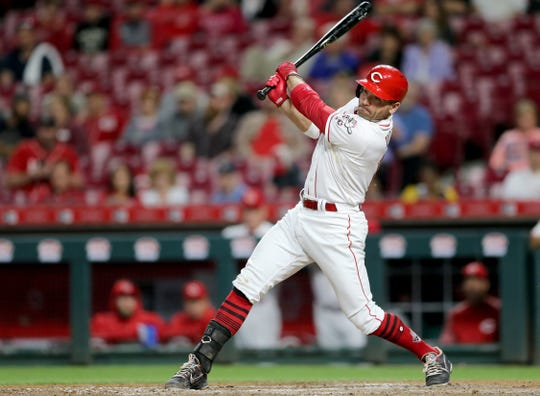 Cincinnati Reds first baseman Joey Votto (19) hits a single in the ninth inning during a baseball game between the Kansas City Royals and the Cincinnati Reds, Wednesday, Sept. 26, 2018, at Great American Ball Park in Cincinnati.