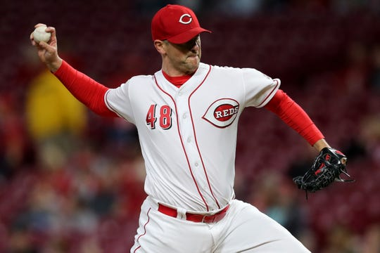 Cincinnati Reds relief pitcher Jared Hughes (48) delivers in the ninth inning during a baseball game between the Kansas City Royals and the Cincinnati Reds, Wednesday, Sept. 26, 2018, at Great American Ball Park in Cincinnati.