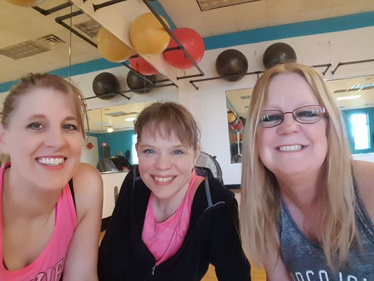Cherie Hughart, Melanie Laughman and Cookie Huber get a sweaty selfie in after class one afternoon
