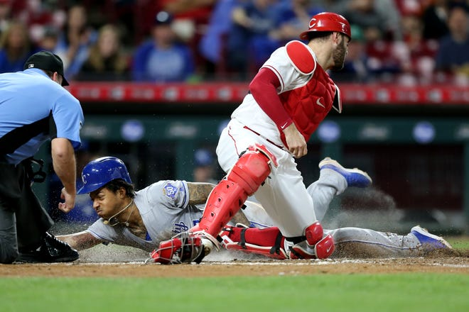 Kansas City Royals second baseman Adalberto Mondesi (27) scores in the fifth inning during a baseball game between the Kansas City Royals and the Cincinnati Reds, Wednesday, Sept. 26, 2018, at Great American Ball Park in Cincinnati.