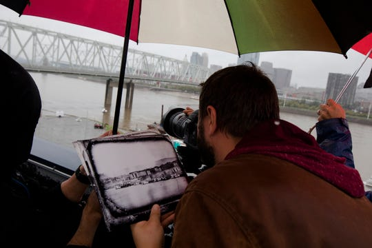 Chris Ashwell, sets up the Hasselblad H6D on Sept. 24, 2018, at the Newport Aquarium in Newport, to recreate the F & P Panoramic image of 1848.