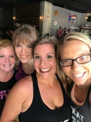 Sylvia Hammons, center, brought her dance fusion students downtown for a special Saturday workout. From left, Ruth Bowman, Melanie Laughman, Sylvia and Brittney Cobbs.