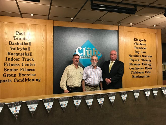The Club at Woodbridge owners (from left) Jeffrey Zirpolo and his brother, Ray, with Woodbridge Mayor John McCormac.