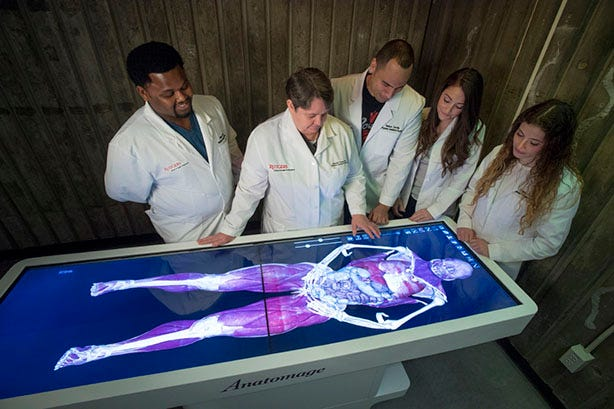 From left to right: Delroy Allen (SHP '20), Assistant Professor Primary Care Rebekah Thomas, Nelson Zorilla (SHP '20) Victoria Latella (SHP '20), and Lindsey DuBoff (SHP '20) work with an anatomage table.