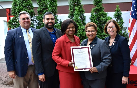 Union County Freeholder Chairman Sergio Granados and Freeholders Alexander Mirabella and Rebecca Williams present a resolution to Union County College President Dr. Margaret McMenamin and Dr. Victoria C. Ukachukwu, Dean of the Union County College Plainfield Campus, congratulating them on the 25th Anniversary of the Union County College Campus in Plainfield.