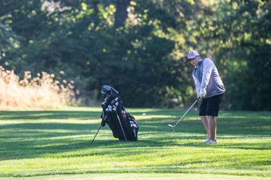 RJ Channon, deaf student athlete at East High School, chips on to the green while playing in a high school tournament on Wednesday, Sept. 26, 2018, at Bright Grandview Golf Course.