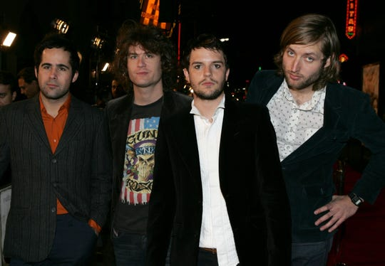 """From left, Ronnie Vannucci, David Keuning, Brandon Flowers and Mark Stoermer of the band The Killers arrive at the premiere of """"Alexander"""" at Grauman's Chinese Theater on November 16, 2004, in Hollywood, California."""