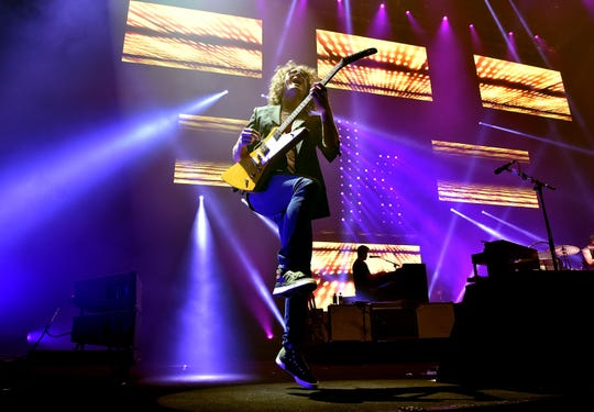Musician Dave Keuning of The Killers performs onstage during the grand opening of T-Mobile Arena on April 6, 2016, in Las Vegas.