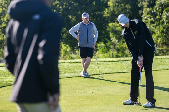 RJ Channon, deaf student athlete at East High School, watches his competitors putt during a tournament on Wednesday, Sept. 26, 2018, at Bright Grandview Golf Course.