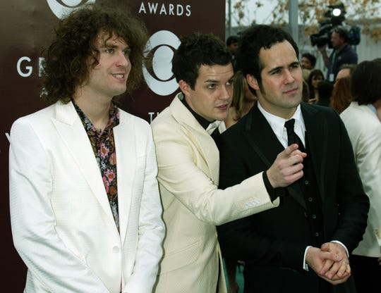 Guitarist David Keuning, vocalist/keyboardist Brandon Flowers and drummer Ronnie Vannucci of Killers arrive to the 47th annual Grammy Awards at the Staples Center February 13, 2005, in Los Angeles.