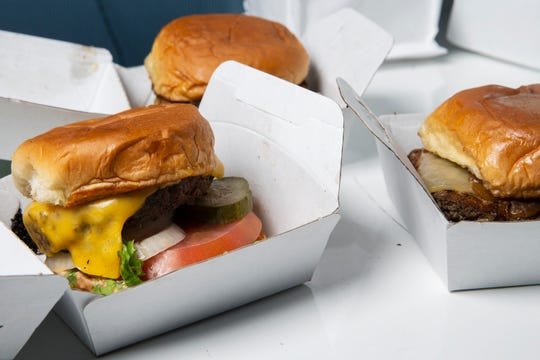 Three burgers from Wahlburgers photographed in the Des Moines Register photo studio before a taste test on Wednesday, Sept. 27, 2018, in Des Moines.