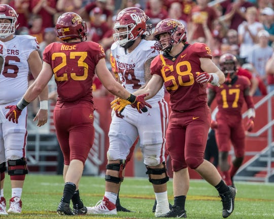 Iowa State's Spencer Benton, 58, and Mike Rose, 23 high five during a game against Oklahoma on Sept. 15, 2018.