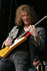 David Keuning of The Killers performs onstage at the Virgin Festival by Virgin Mobile on September 23, 2006 in Baltimore, Maryland.