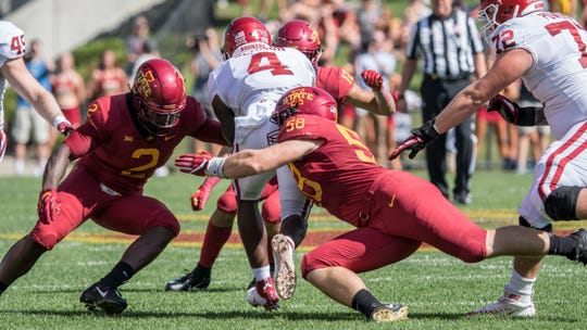 Iowa State's Spencer Benton, 58, and Willie Harvey, 2, make a play against Oklahoma on Sept. 15, 2018.