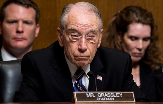 Sen. Chuck Grassley, R-Iowa, listens as Christine Blasey Ford testifies during the Senate Judiciary Committee hearing, Thursday, Sept. 27, 2018, on Capitol Hill in Washington.
