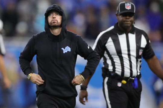 Eminem leaves the field after the coin toss before the Detroit Lions played against the New York Jets Monday, September 10, 2018, at Ford Field in Detroit, Mich.