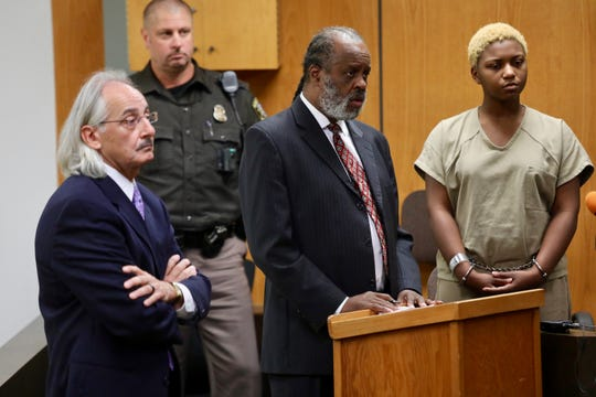 Assistant prosecutor Bill Cataldo, defense attorney Mark Brown and defendant Tanaya Lewis, stand in court during a probable cause hearing for Lewis who is charged with first-degree premeditated murder in the stabbing death of Danyna Gibson at 37th District Court in Warren on Thursday, Sept. 27, 2018.