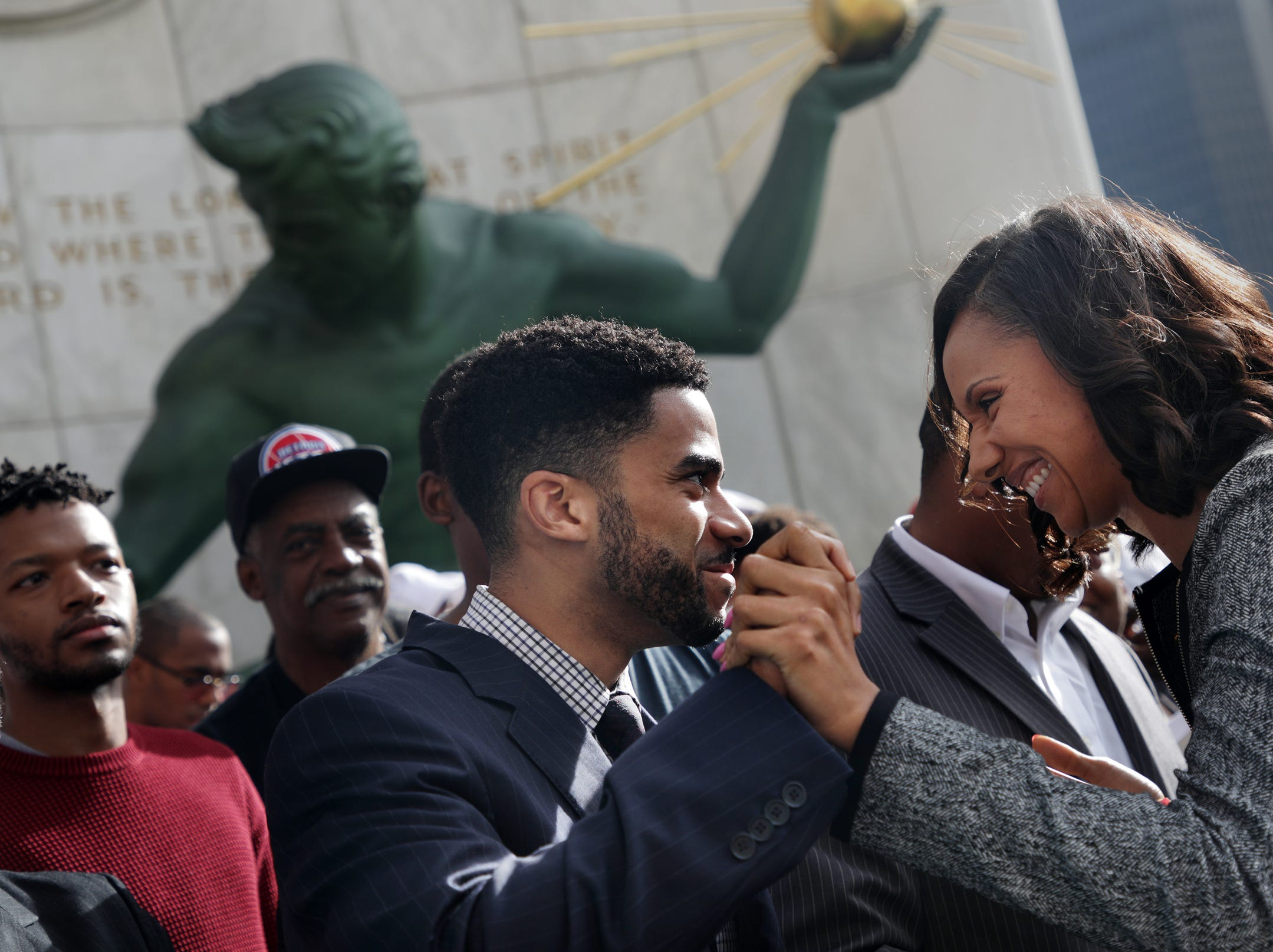 Detroit City Council President Pro Tempore Mary Sheffield, right and Damion Ellis high five during during the introduction of a package of legislations called the People's Bills on Monday, September 17, 2018 in front of the Coleman A. Young Municipal Center in Detroit.