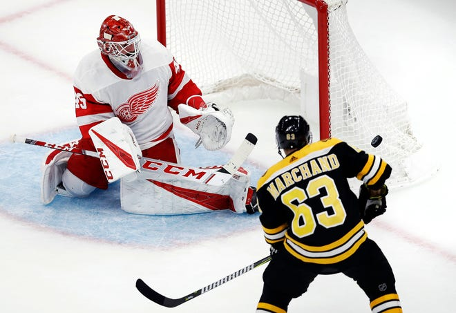 Red Wings goaltender Jonathan Bernier makes a save against Bruins left wing Brad Marchand during the first period of a preseason game in Boston, Wednesday.