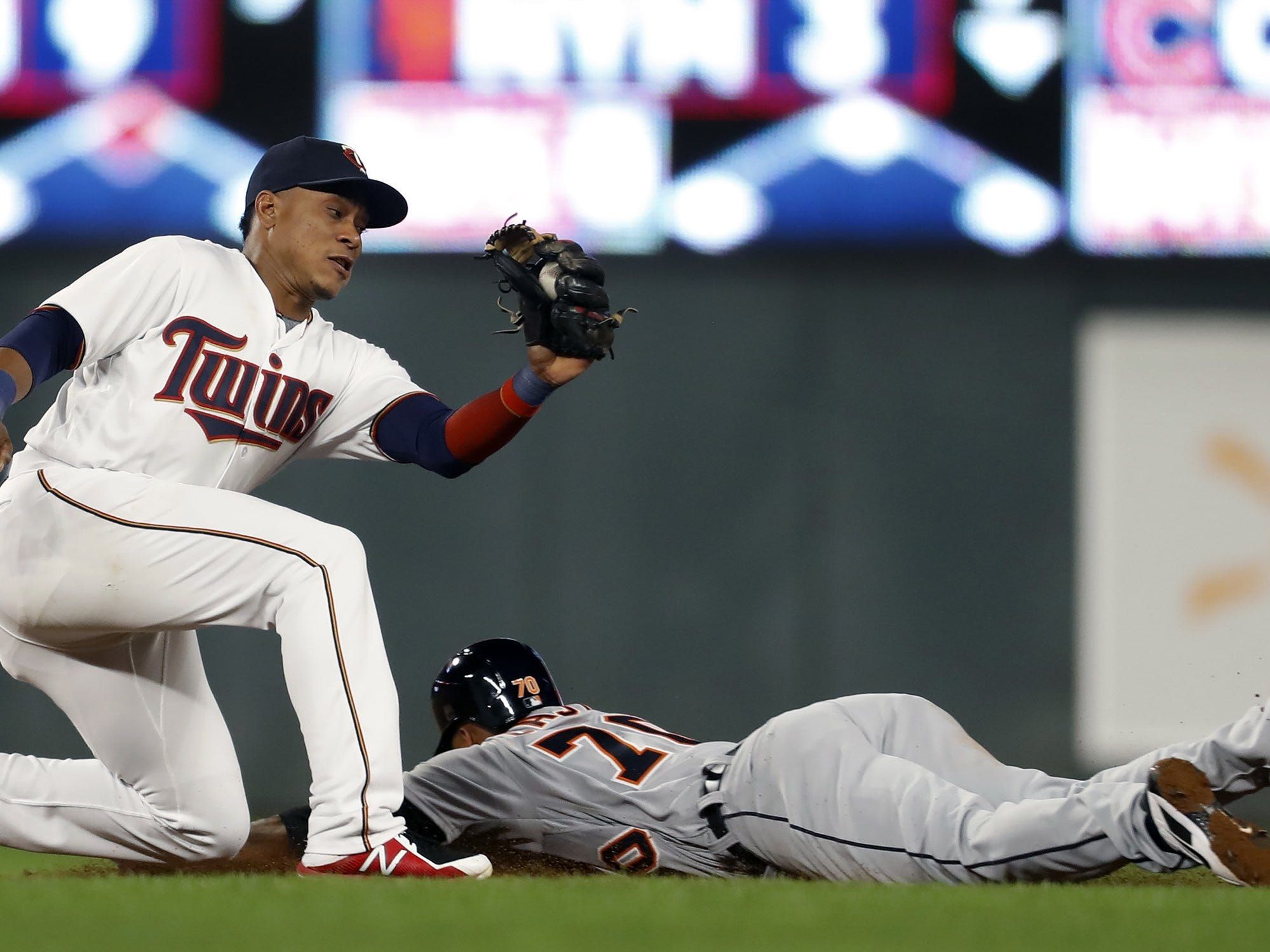 The Detroit Tigers' Harold Castro (70) steals second base in the eighth inning as Minnesota Twins infielder Jorge Polanco, left, is late with the tag at Target Field in Minneapolis on Tuesday, Sept. 25, 2018. The Tigers won, 4-2.