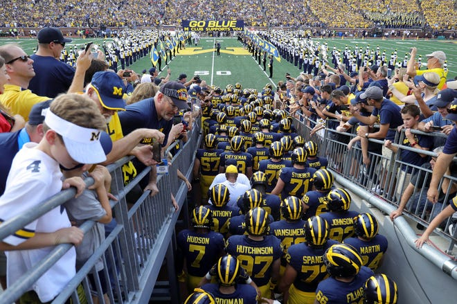 Michigan fans watch as the Wolverines take the field Sept. 15.