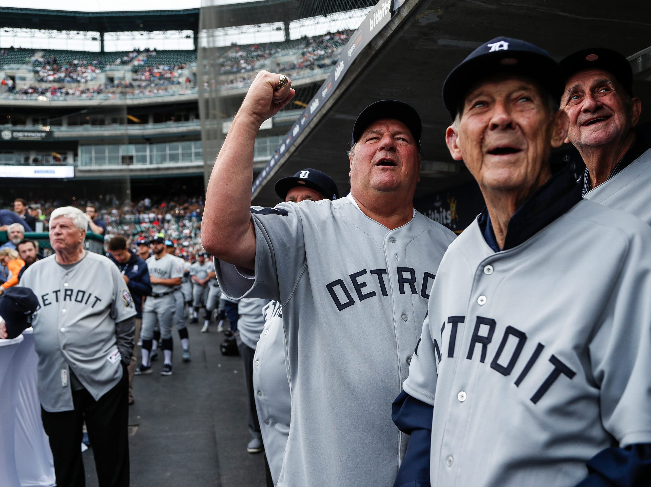 Former Tigers Jon Warden, center, coach Hal Naragon, third base Don Wert, far right, cheer as they watch highlights from the 1968 season during Detroit Tigers celebration of the 50th anniversary of 1968 World Series championship at Comerica Park in downtown Detroit, Saturday, September 8, 2018. Former catcher Jim Price is on far left.