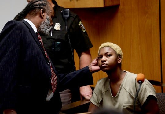 Defense attorney Mark Brown looks at his client, Tanaya Lewis' head after she entered the courtroom at 37th District court on Thursday,  Sept. 27, 2018, for a probably cause hearing. Lewis is charged with first-degree murder in the stabbing death of classmate Danya Gibson, 16, at Fitzgerald High School.