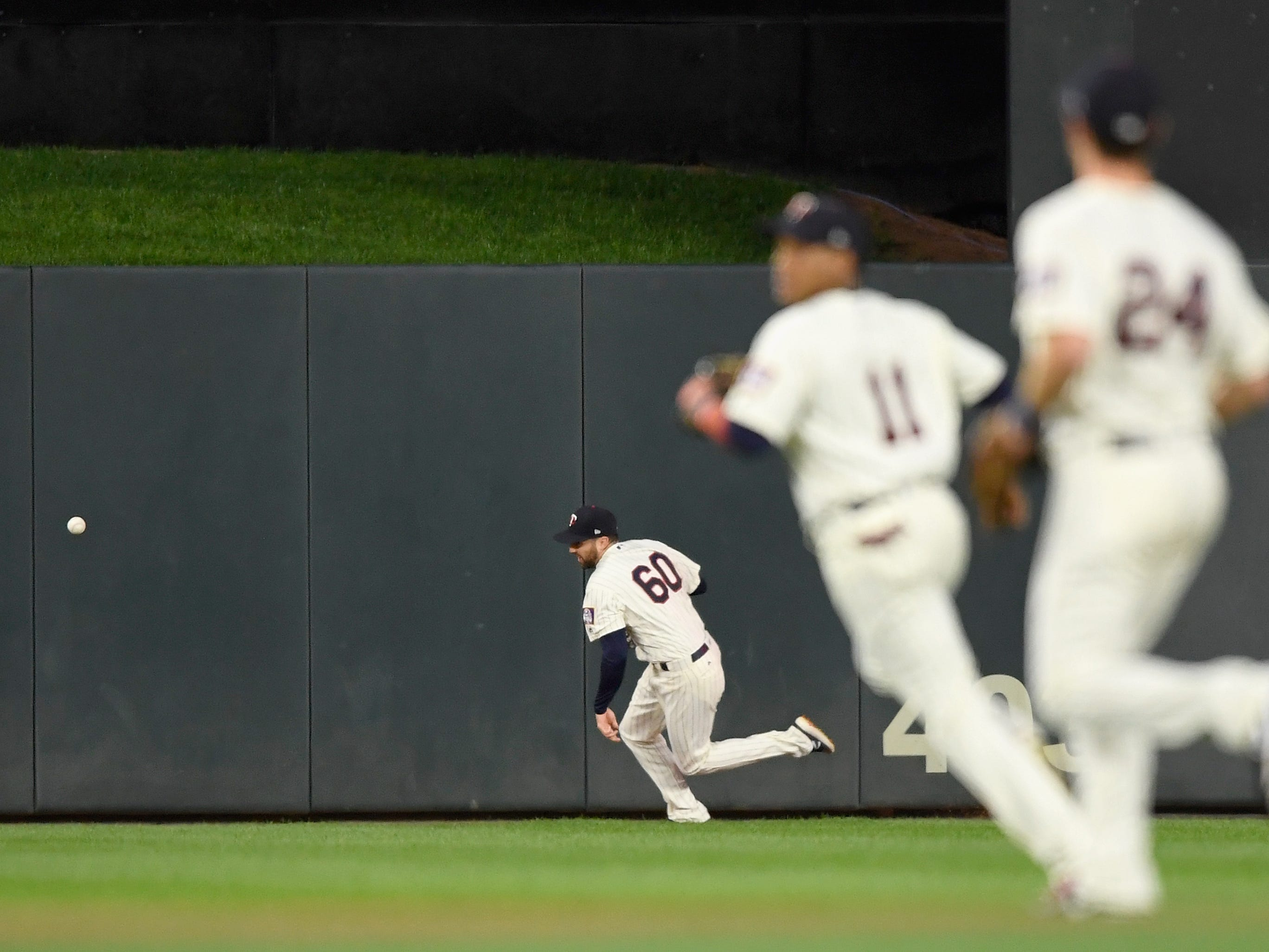 Jake Cave #60 of the Minnesota Twins runs after an RBI triple hit by Christin Stewart #14 of the Detroit Tigers during the first inning of the game on September 26, 2018 at Target Field in Minneapolis, Minnesota.
