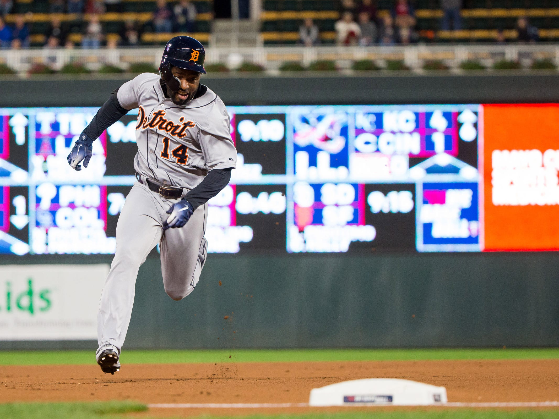 Detroit Tigers outfielder Christin Stewart (14) attempts an inside the park home run in the first inning against the Minnesota Twins at Target Field on Sept. 26, 2018.