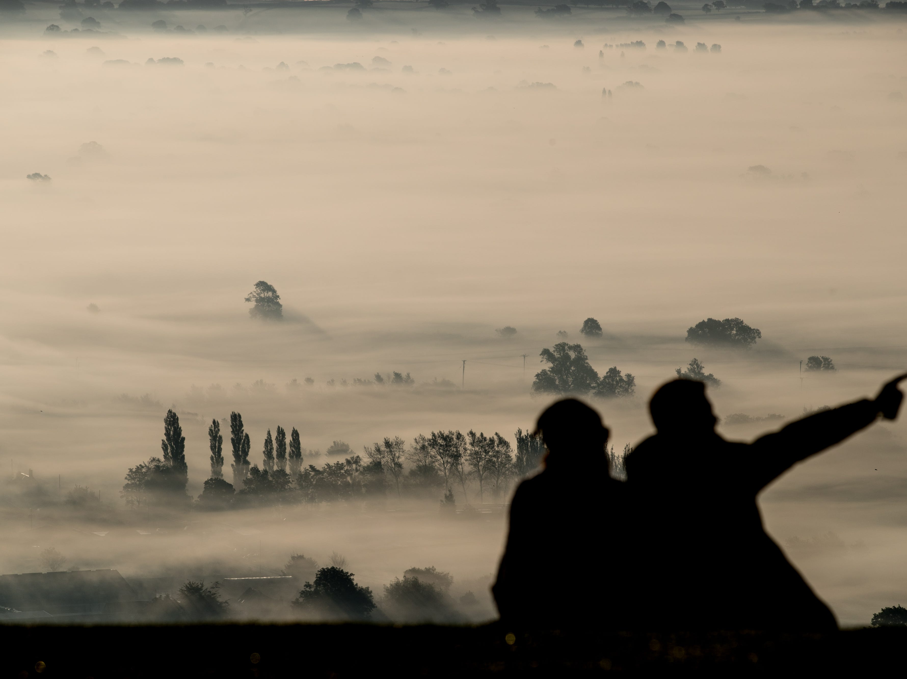 Early morning mist lingers as the sun rises  in Glastonbury on September 27, 2018, in Somerset, England. After the hottest summer on record, weather forecasters are predicting that today could be the last warm day of the year for some parts of the UK, with temperatures expected to reach 75F (24C) in the South East this afternoon, unlikely to be repeated.