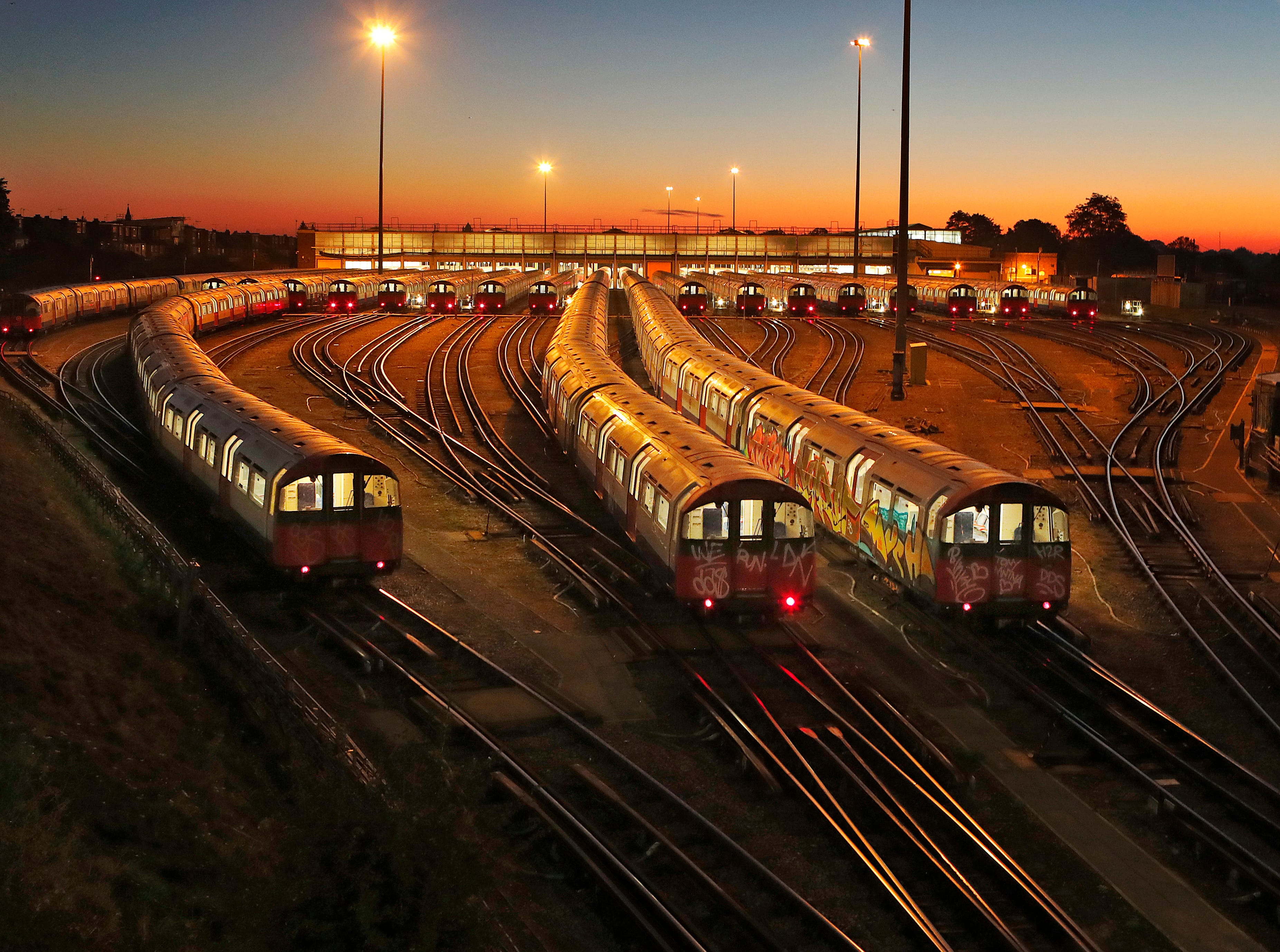Piccadilly Line underground trains are parked at a depot at Boston Manor station in London, at sunrise on Thursday, Sept. 27, 2018. Tens of thousands of commuters face misery during their journeys Thursday as the Piccadilly Line, part of the London Underground network, began the 48 hour strike on Wednesday afternoon.