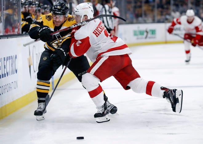 Red Wings defenseman Joe Hicketts, right, checks Bruins ' Jordan Szwarz during Tuesday's 3-2 preseason overtime win.