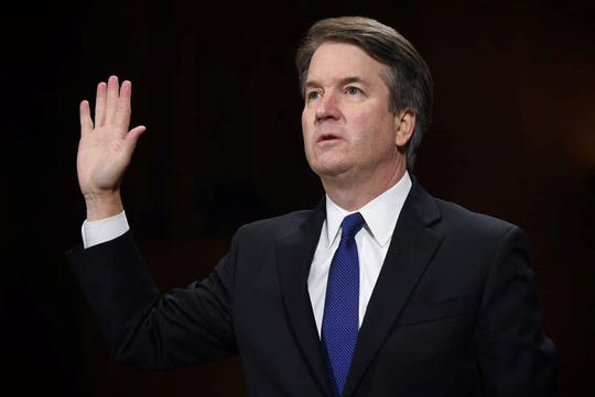Supreme Court nominee Judge Brett Kavanaugh takes the oath before the US Senate Judiciary Committee in the Dirksen Senate Office Building on Capitol Hill September 27, 2018 in Washington, DC.