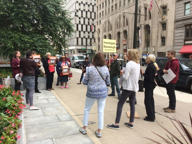 About two dozen members of Stop Trump Ann Arbor protested the Senate confirmation hearings of Brett Kavanaugh in downtown Detroit on Sept. 27, 2018.