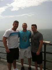 Cullen Finnerty with brothers Brendan, center, and Tim, in Huntington Beach, Calif.