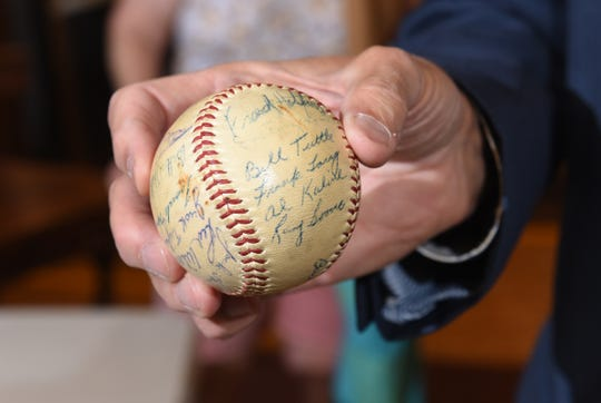 Robert Pearce shows his 1955 Detroit Tigers autographed baseball at DuMochelles Art Galleries in Detroit.