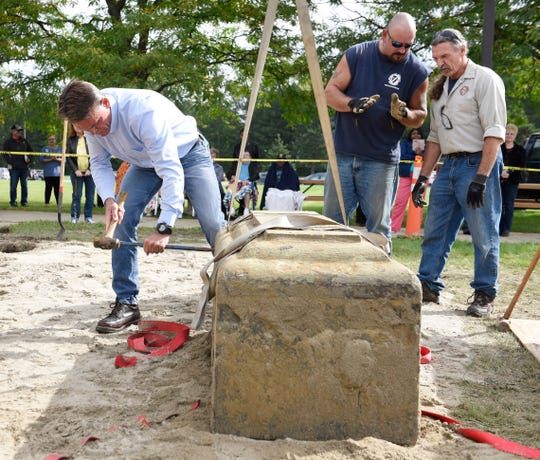 Macomb County Executive Mark Hackel opens a 30-year-old time capsule buried in Macomb County.
